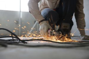 Hand held grinder in operation with sparks