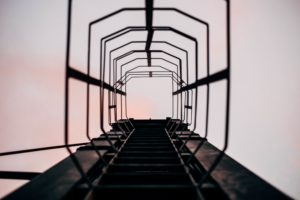 Looking up a steel fire escape ladder
