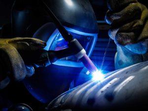 an engineer welding showing a bright arc